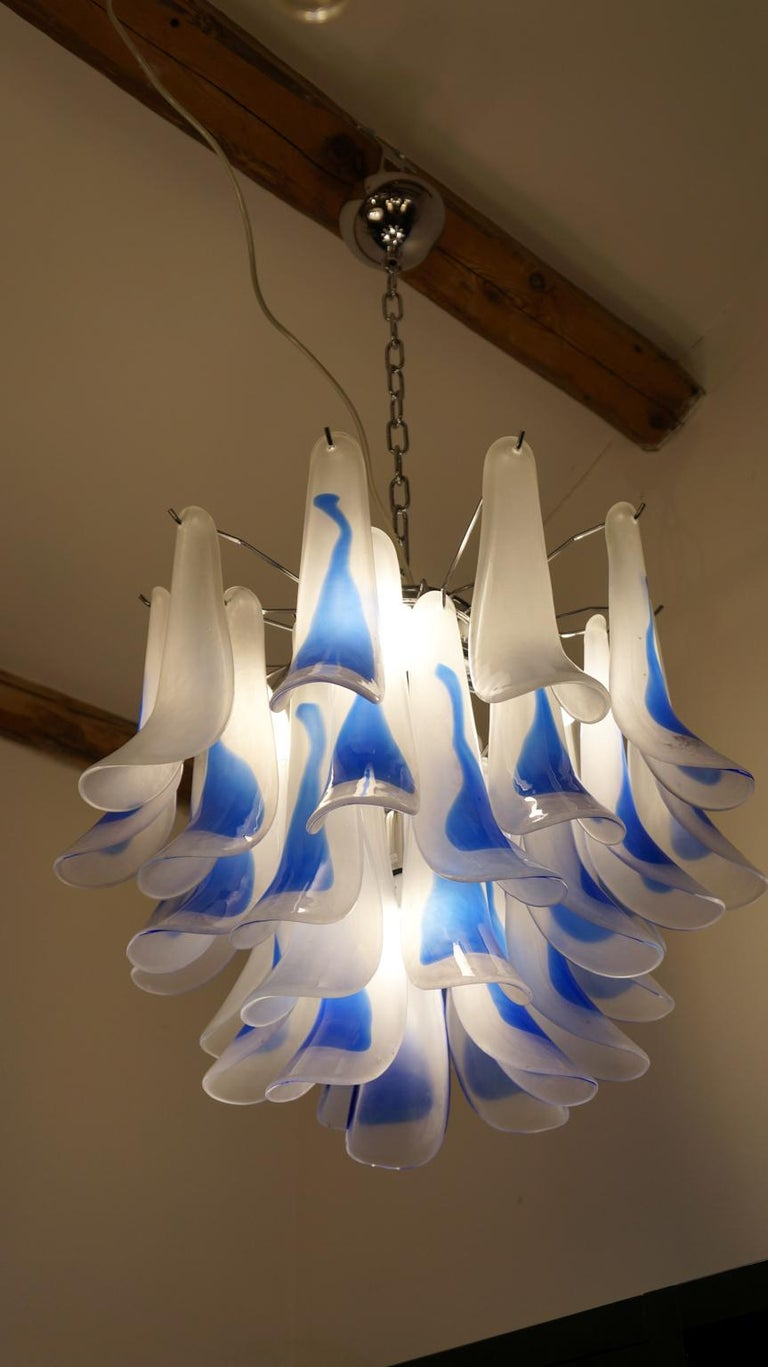 A very elegant chandelier, with glass elements called