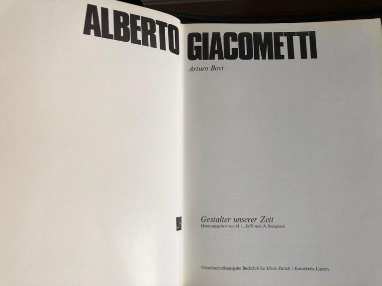 Alberto Giacometti by Arturo Bovi Album, Switzerland 1974, measures: 31 x 24.4 x 1.4 cm.