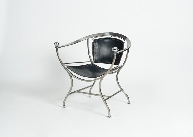 Polished steel and leather modernist armchair by Italian designer Alberto Orlandi, 1980s.
