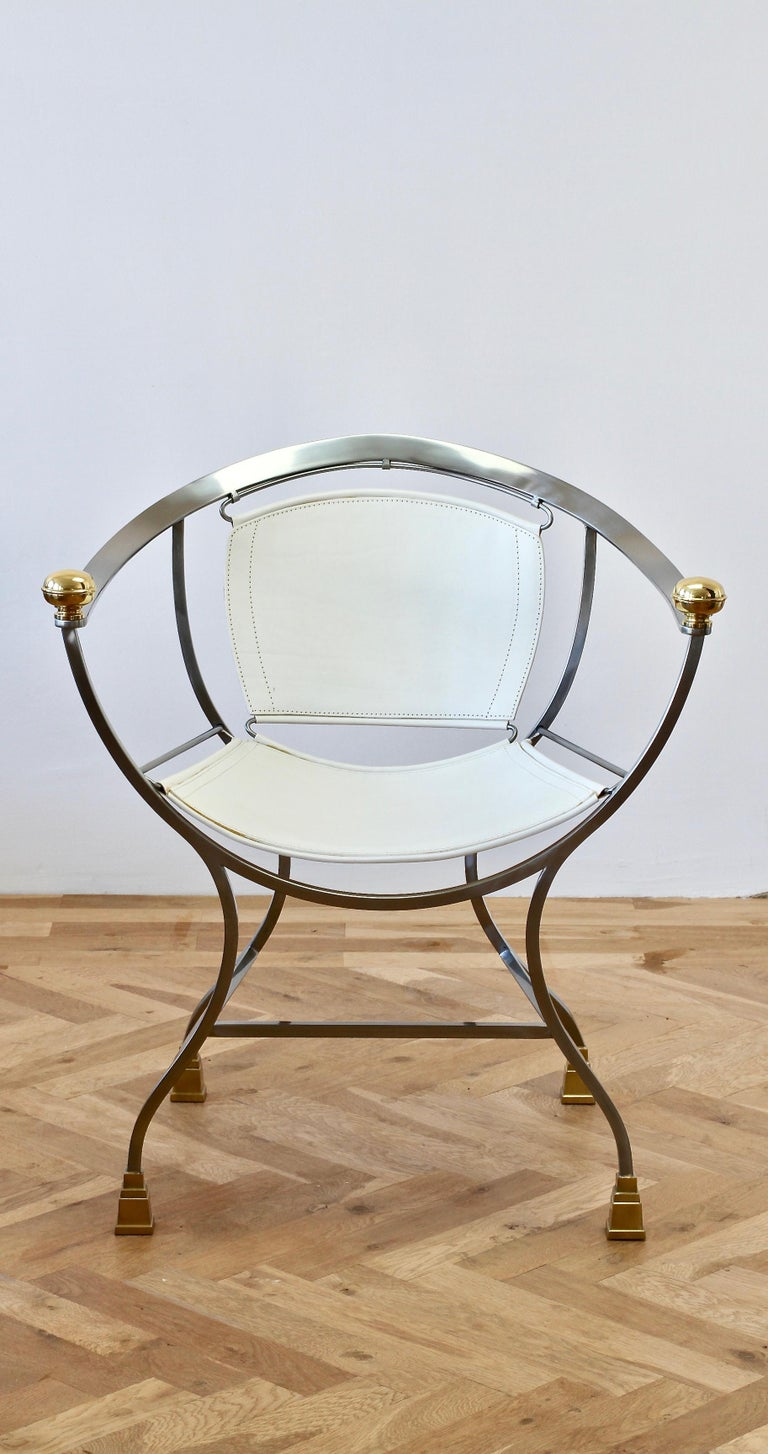 Rare vintage set of four 'Pompeii' armchairs or seats by Italian designer Alberto Orlandi, circa late 1970s-early 1980s. Made in Italy and featuring polished steel, solid cast brass feet and armrest details with white leather seat and backrest.