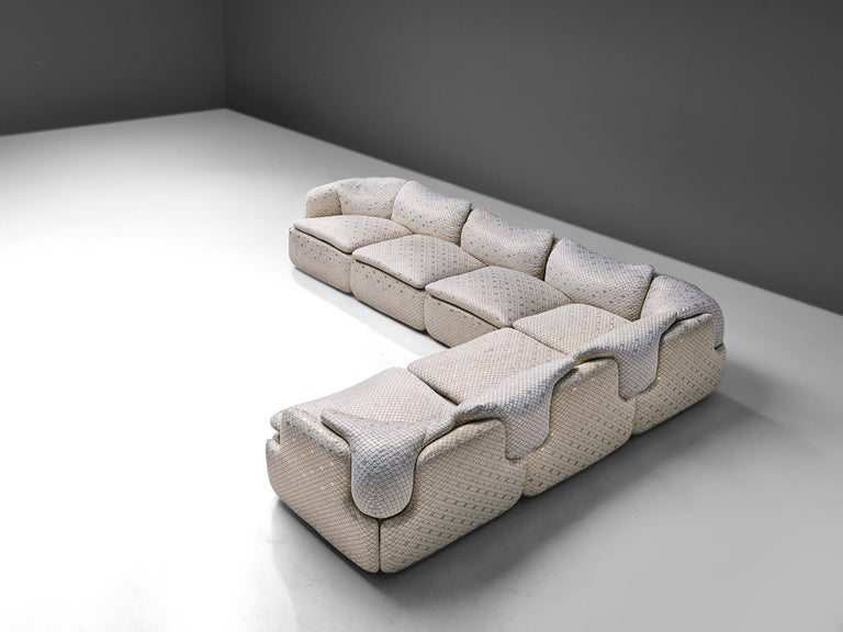 """Alberto Rosselli for Saporiti, """"Confidential"""" corner sofa, in iridescent scale pattern upholstery, Italy, 1970s.  Modular corner sofa designed by Italian architect Alberto Rosselli in 1972 for Saporiti Italia. The shiny white upholstery is shows a"""