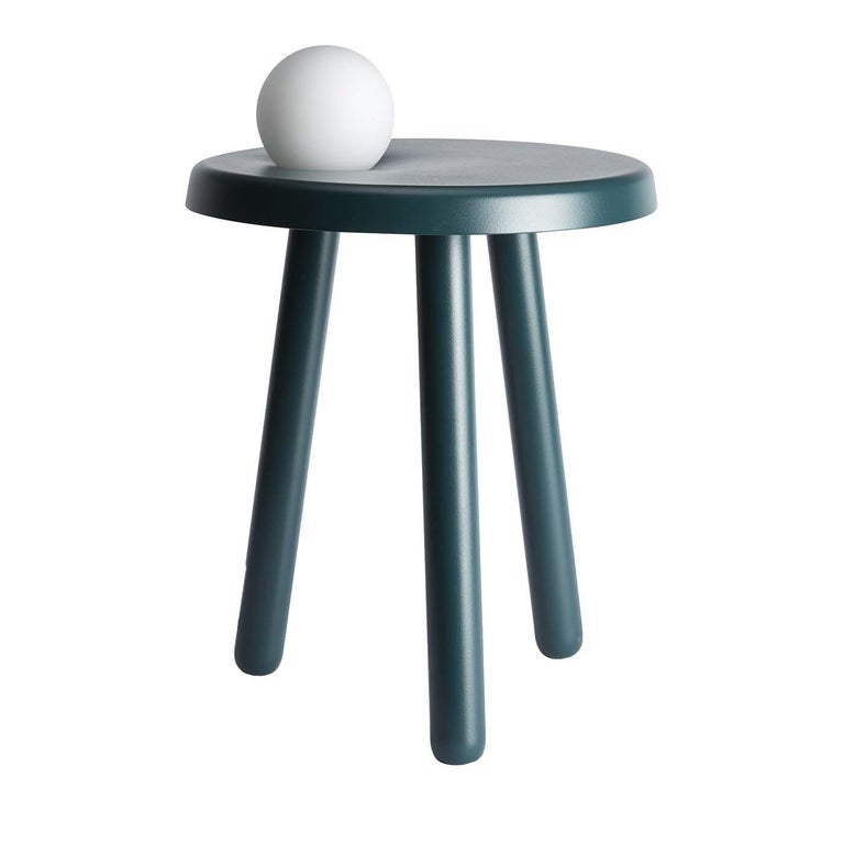 Inspired by Albert Einstein's Theory of Relativity, this side table is an Exclusive Design by Matteo Fiorini for Mason Editions. Crafted of iron in a vivid blue-green color, it features three slanted cylindrical legs with rounded feet. The circular