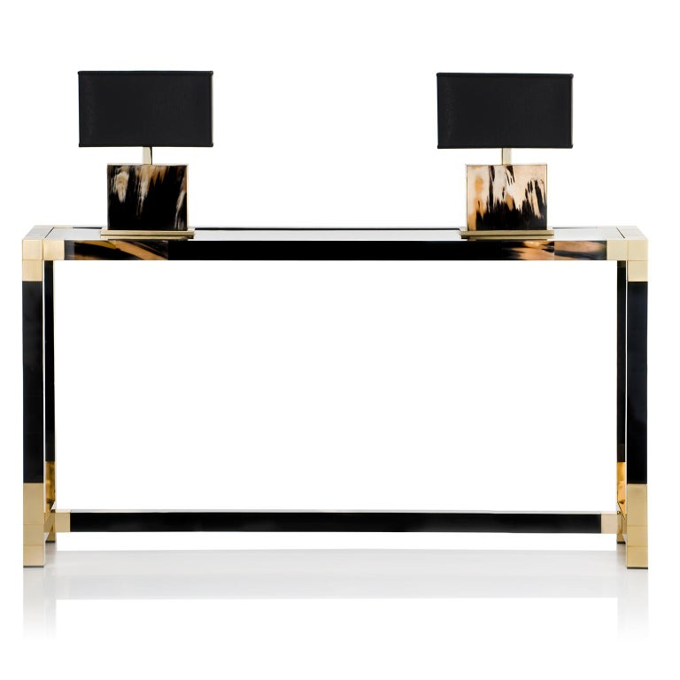 Minimalistic contemporary style and sophisticated design blend in Alcamo console table, the perfect living room or entrance hall accompaniment for the modern home. Its rigorous rectangular structure in glossy black lacquered wood is graced by