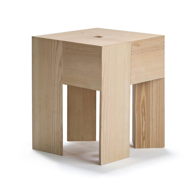 Stool or side table designed by Aldo Bakker in 1996.  The Dutch designer, Aldo Bakker, is known for his uncompromising approach to design. This is a perfect example of his work. TriAngle consists of 12 triangular elements—cut to fit together like