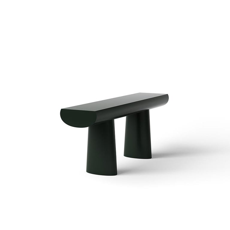 Console table designed by Aldo Bakker in 2017.   Tranquil and seductive, Aldo Bakker's console table floats exquisitely between sculpture and furniture. It depicts the simplest concept of a table: two columns and a surface. The legs are an