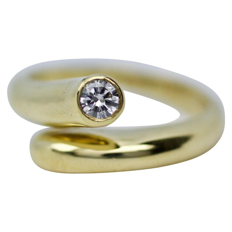 Cartier gold single-diamond wraparound ring, 1970, offered by Heirloom Jewelers
