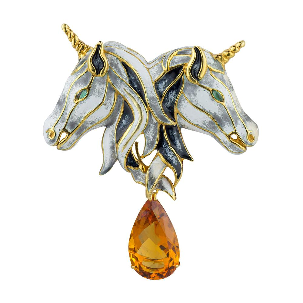 A 1974 gold, enamel and citrine brooch by Aldo Cipullo, offered by Vendome Collection Inc.