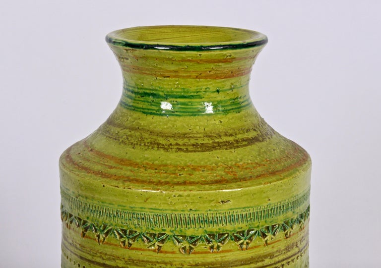 Tall Aldo Londi Bitossi for Rosenthal Netter hand imprinted glazed vessel in chartreuse, earthen brown with orange highlights. Natural. Organic. Hand crafted. Label to underside partially visible. Never used with liquid. Pristine condition.