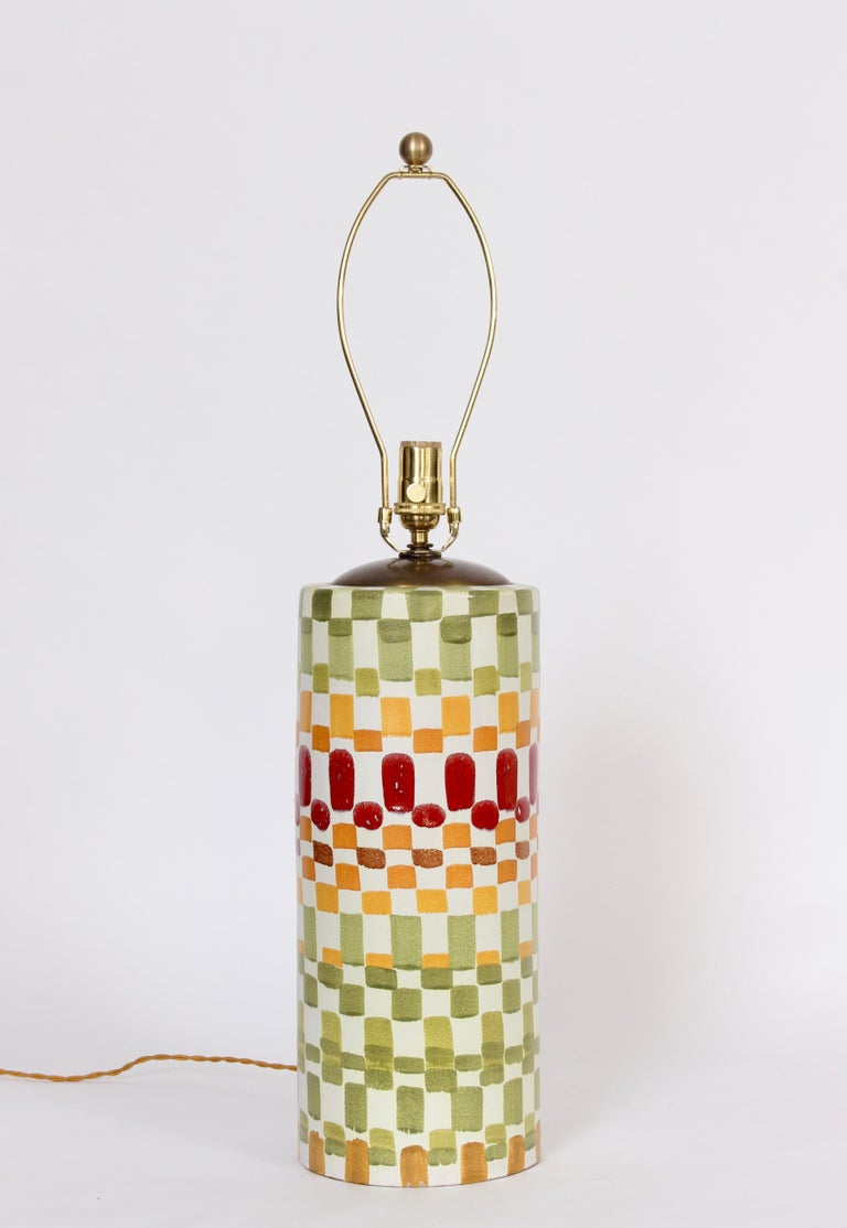 Aldo Londi for Bitossi multicolored checkerboard glazed ceramic table lamp. Featuring a reflective glazed white column with hand painted repeated square pattern in greens, gold red and orange. Shade shown for display only (11 H x 17 D top x 18 D