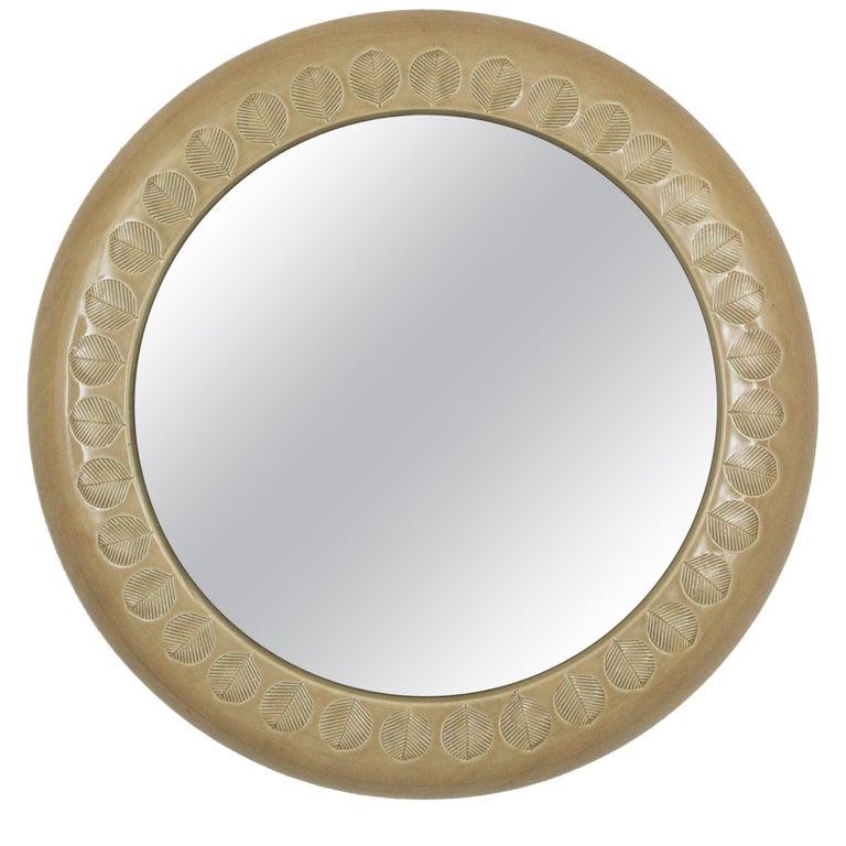 Round wall mirror by Aldo Londi for Bitossi, beige glazed ceramic and leaf motifs, Italy, 1960s. Italian Mid-Century Modernist handcrafted beige-taupe terracotta glazed ceramic circular mirror with leaf pattern design. Aldo Londi is widely known