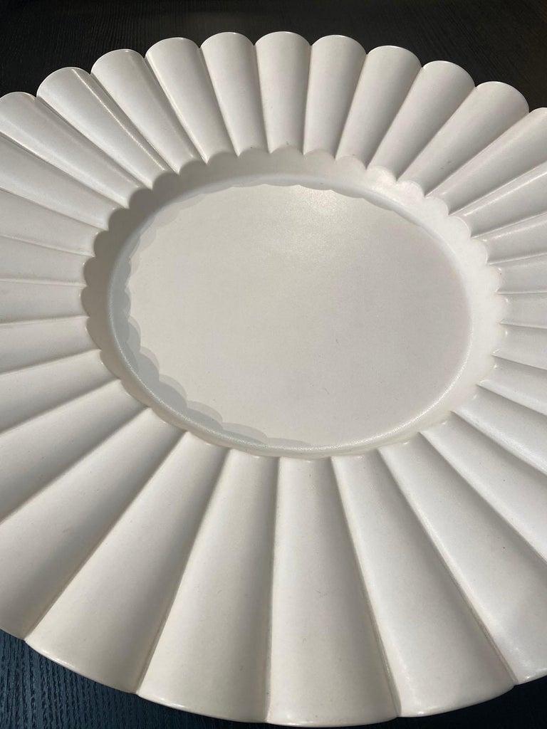 Aldo Rontini White ceramic tray 2000 Ceramic Faenza Signed: A. Rontini Feanza - numbered 02/50 Measures: Diameter 49 cm Height 6cm.