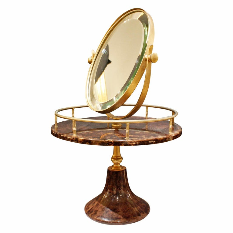 Adjustable vanity mirror with base in lacquered chocolate goatskin with gold-plated hardware by Aldo Tura, Milan Italy, 1970s (signed on bottom). This piece is rare and very luxurious.