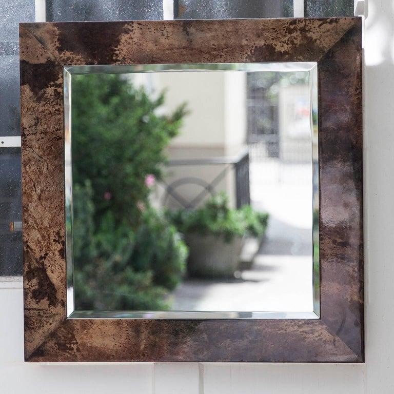Aldo Tura chocolate brown goatskin parchment wall mirror, Italy, 1960s Measures: 70 H x 70 B x 2 D cm. Along with artists like Piero Fornasetti and Carlo Bugatti, Aldo Tura (1909-1963) definitely belonged to the mavericks of Italian design.