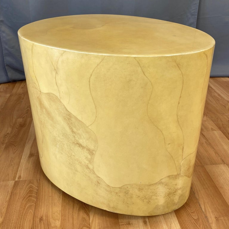 A rare late 1960s sculptural egg-shaped side or cocktail table in lacquered goatskin by noted Italian designer Aldo Tura.  Clean, minimalist form with a striking and substantial polished stone-like presence. Completely clad in meticulously fitted
