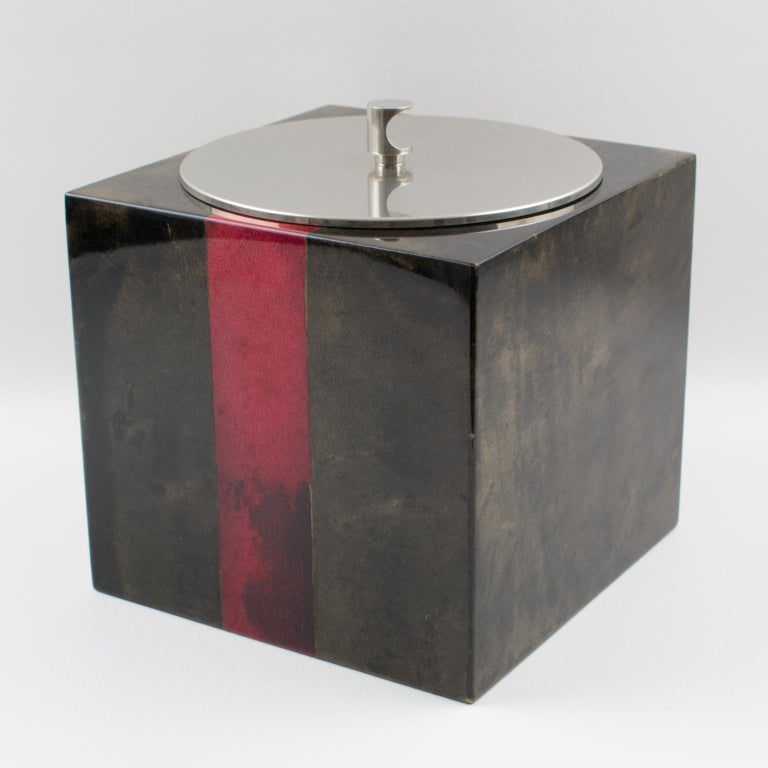 Very stylish lacquered goatskin and chromed metal ice bucket by Italian designer Aldo Tura from the 1960s. Goatskin vellum covered square ice bucket in a rich brilliant brown color contrasted with oxblood red color strips, with a chromed metal lid