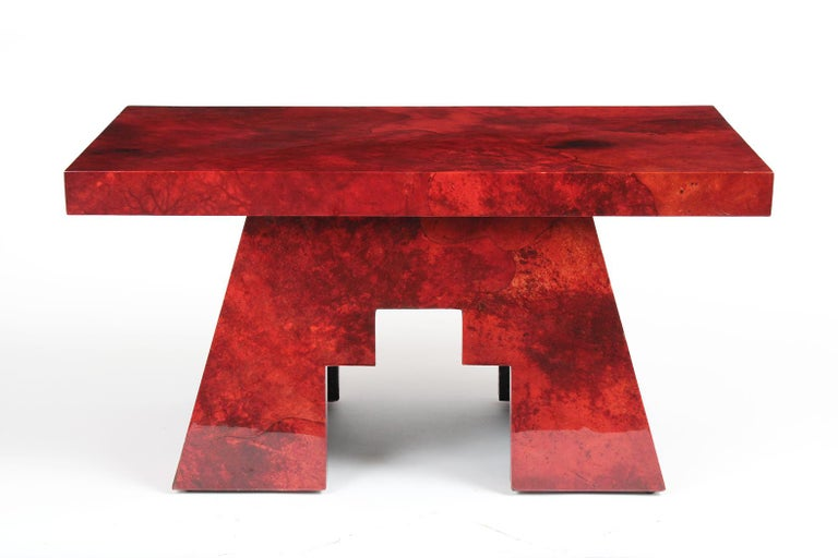 This red goatskin lacquered side table by Aldo Tura side table is in great condition and has a unique design. The side table has a rectangular top, asymmetrical leg design, and has been dyed in deep red color with lacquer finish. This side table by