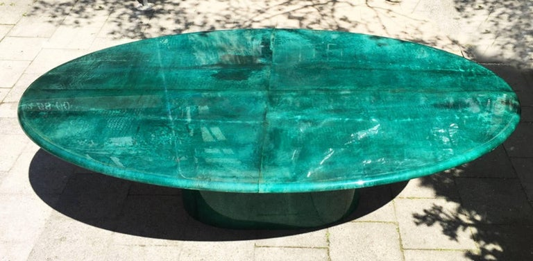 Gorgeous Aldo Tura dining or conference table in deep green goatskin in excellent condition, Italy, 1970s. Measures: 220 x 130 x 76 cm.