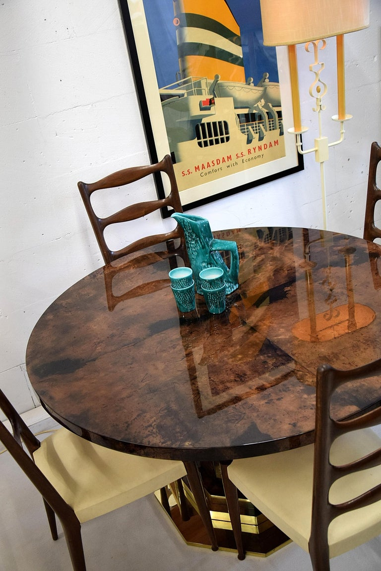 Stunning mid-century brown goatskin and brass Aldo Tura dining table in fantastic condition. A truly rare and beautiful dining table that will look great in just about any stylish and classy interior. The table will be shipped overseas disassembled