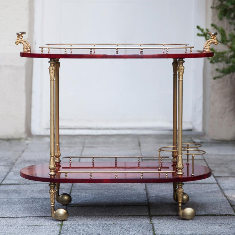 Wonderful bar cart of Aldo Tura in lacquered goatskin. This serving cart was executed, circa 1960 in a red parchment. Along with artists like Piero Fornasetti and Carlo Bugatti, Aldo Tura (1909-1963) definitely belonged to the mavericks of Italian