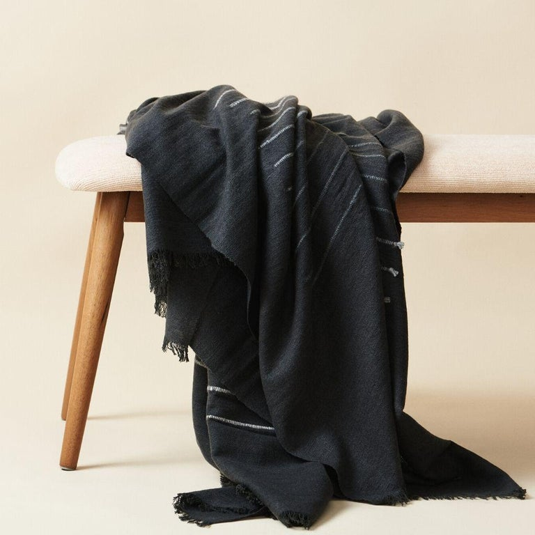 Custom design by Studio Variously, ALEI  throw / blanket is handwoven by master weavers in Nepal and dyed entirely with earth-friendly dyes & soft merino yarn that is hand spun. A sustainable design brand based out of Michigan, Studio Variously