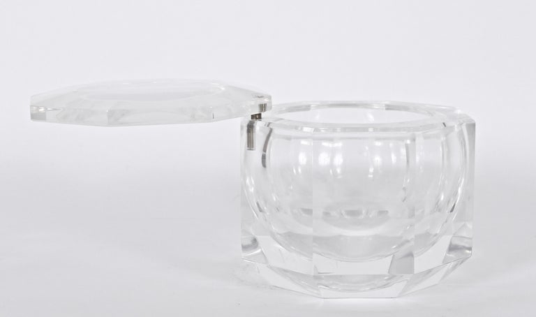 Italian Modern Alessandro Albrizzi Faceted Clear Lucite ice bucket with pivoting Lucite Cap. Featuring a rounded and heavy Lucite form with circular Swing top. Refracting. Reflective. Hollywood Regency. Three dimensional. Gem like. Made in Italy.