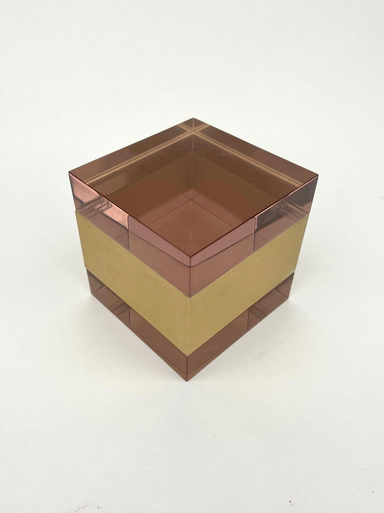 This auction is for a purple cube Lucite box with gold color metal in the centre by Italian Designer Alessandro Albrizzi. Overall the piece is beautiful with a wonderful color scheme and an elegance that is hard to come by these days.