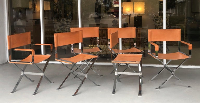 A set of 6 chic chairs by Alessandro Albrizzi. Heavy nickel frames with recent stitched saddle leather seats and backs. 2 armchairs and 4 sides.