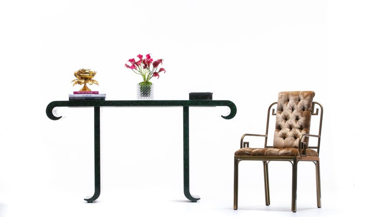 This Baker Furniture console is by acclaimed designer Alessandro Gabrielli Gambalogna globally regarded as a master of faux finish techniques - here a faux hand applied malachite finish on a sculptural pagoda form console. Baker Furniture acclaimed