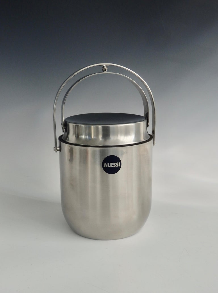 Alessi stainless steel with lid that retracts with the handle. Does have an interior lining. Add 3.75 for handle mechanism for a total of 11 tall.