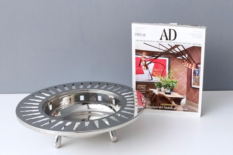 This Alessi stainless steel 3 footed cutout bowl is of deco inspired partial skyscrapers buildings in more of an abstract form. It is in perfect original condition.   Measures: Diameter 32 cm Height 10 cm.