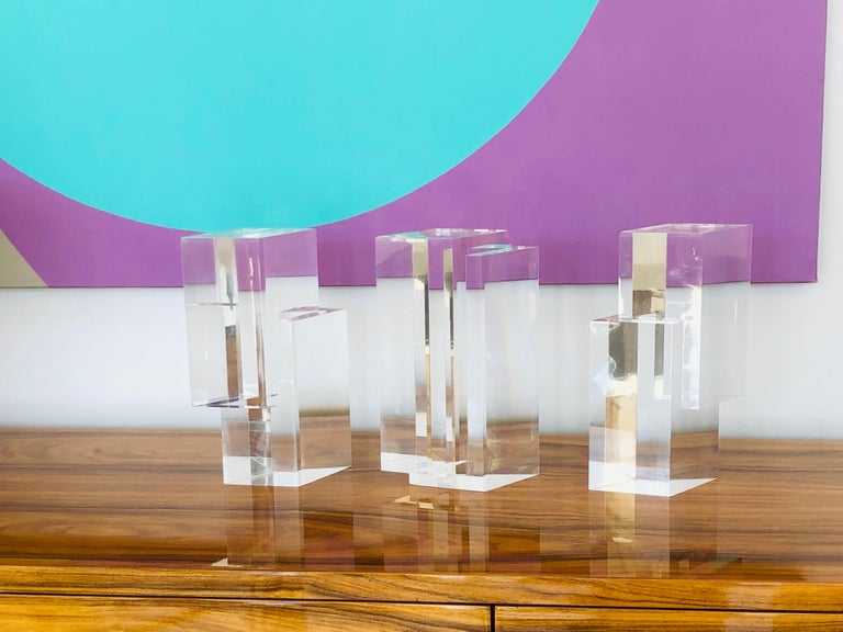 """A 3 piece lucite sculpture by Tasca, signed. Geometric shapes that can be displayed by themselves or in a group. The shapes are precisely crafted, allowing to fit together in multiple ways. Each piece is 10.25"""" tall."""