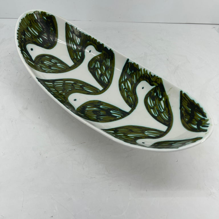 Mid-Century Modern Alessio Tasca green and white ceramic serving platter. This hand painted glazed ceramic Centerpiece is grand and beautiful. It's rich green color with delicate faces of Doves is a statement on display as well as functional serving
