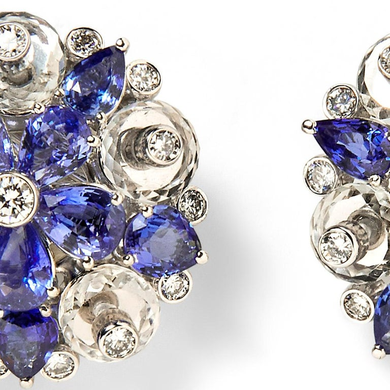 """Diameter of each ear clip is approximately 1"""" 20 pear-shaped sapphires weighing approximately 13.00 carats 2 diamond center stones weighing approximately 0.25 carats 20 round diamond accent stones weighing approximately 2.10 carats 10 faceted rock"""