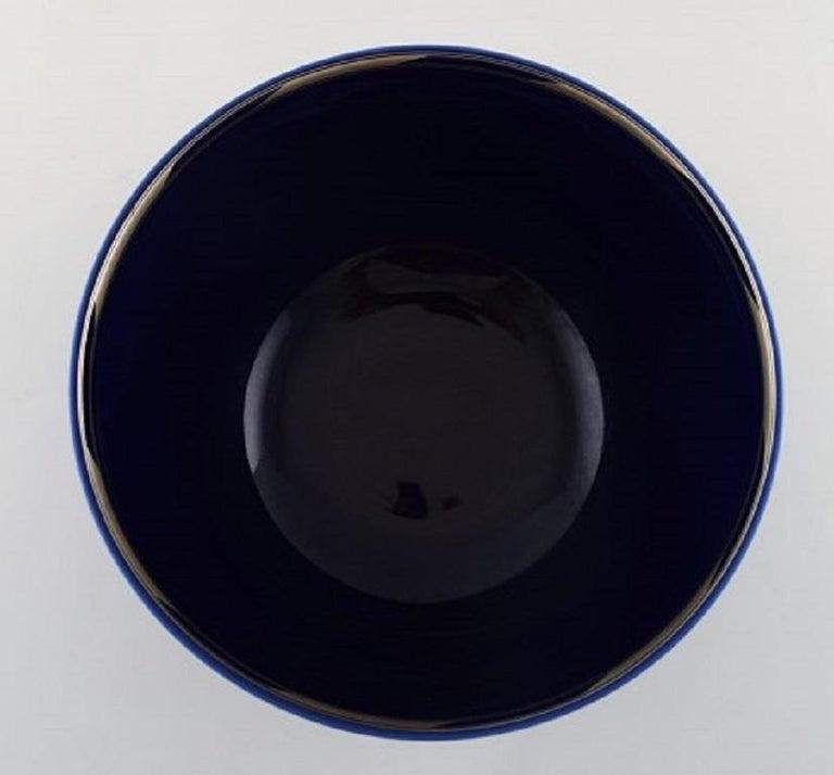 Danish Alev Siesbye for Royal Copenhagen, Bowl of Porcelain Decorated with Blue Glaze For Sale