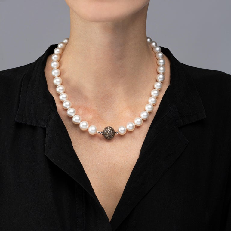 Alex Jona South Sea pearl necklace ( total length 18.5 inch/47 cm), composed of 39 cultured South Sea pearls ranging from  10.2 to 12.7 mm in diameter, strung on a hand-knotted silk cord and secured by a brown diamond pavé ball clasp (212 pieces,