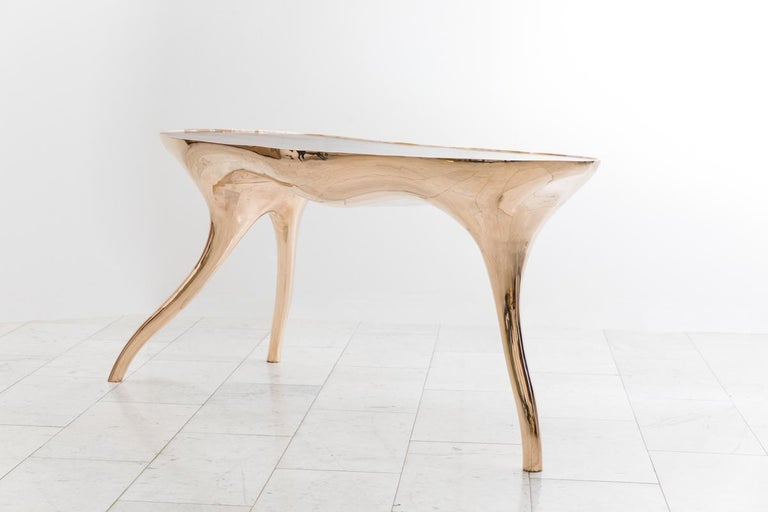 Trois Jambes is a playful take on Roskin's Biche Desk.  Roskin's works blend functional design with modernist sculptural references. A natural successor of innovative artists such as Richard Serra, Jean Arp, and Constantin Brancusi, Roskin's cast