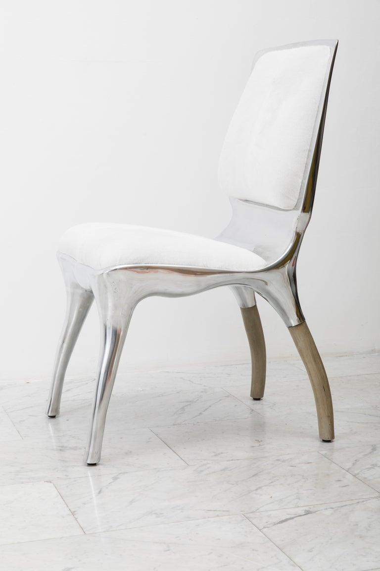 Tusk chair II reflects Alex Roskin penchant for an animality in form. The versatile chair can be used as a salon chair, a desk chair, or grouped for a dining set. The chair features an mammalian physicality, hand-sculpted and cast in aluminum. The