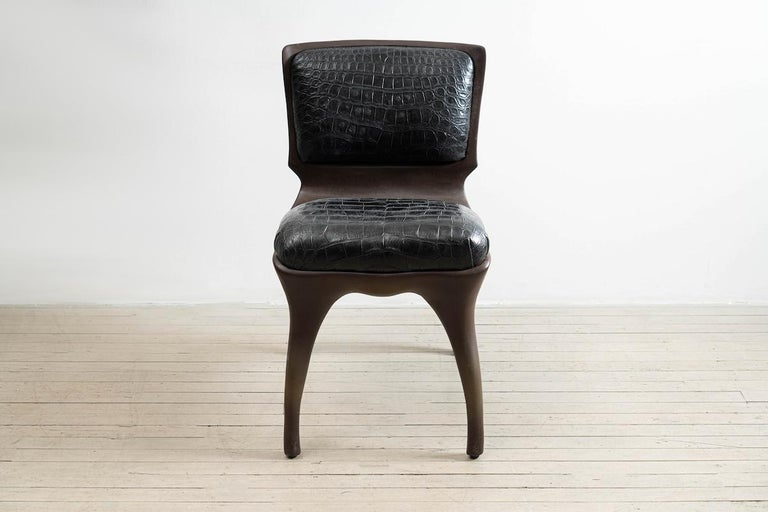 Tusk chair reflects Alex Roskin penchant for an animality in form. The versatile chair can be used as a salon chair, a desk chair, or grouped for a dining set. The chair features an mammalian physicality, hand-sculpted and cast in aluminum. The