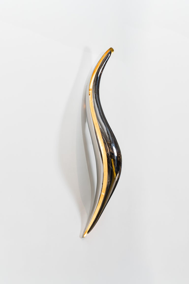 The Vol Light series is Roskin's group of led sculptures combining his signature polished metal forms with LED components.  Roskin's works blend functional design with modernist sculptural references. A natural successor of innovative artists such