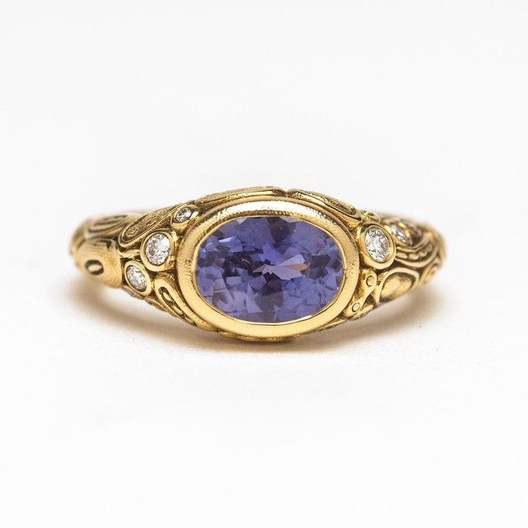From the studio of Alex Sepkus in New York - 18 karat yellow gold ring with stunning oval shaped vivid violet blue sapphire and set with 10 brilliant cut white diamonds. This ring is of heirloom quality you love and expect from Alex Sepkus.  Blue