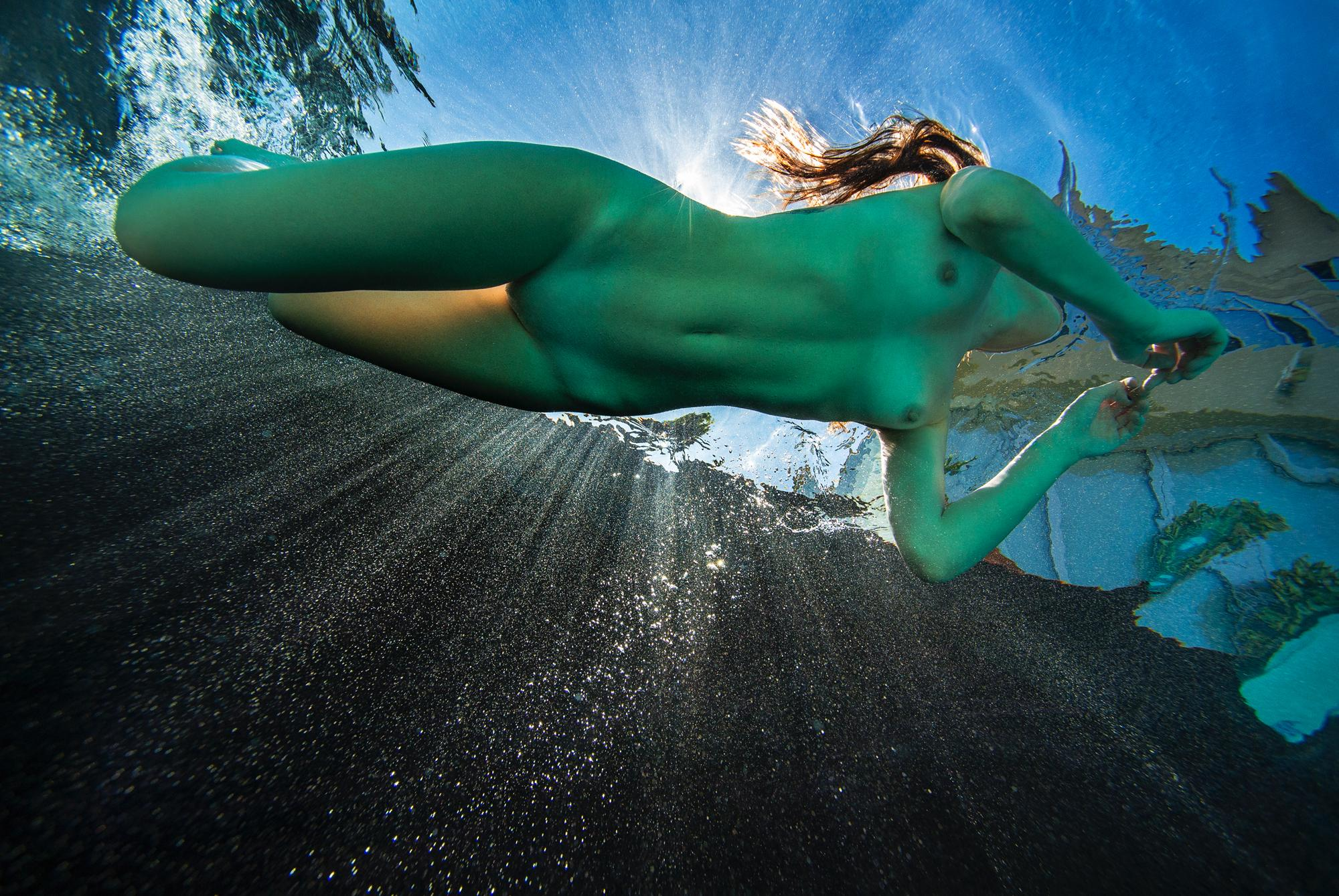 The Real Mermaid - underwater photo of naked young woman in sunbeams