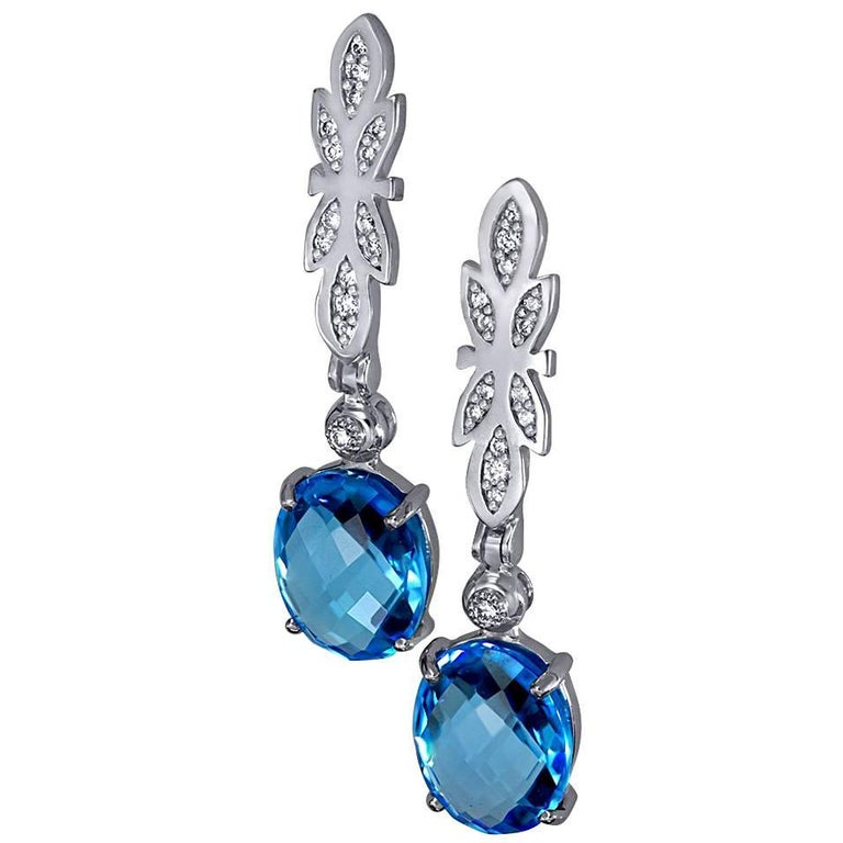 Alex Soldier Equilibrium Earrings are made in 18 karat white gold with blue topaz (7 ct.) and white diamonds (0.2 ct.). Handmade in NYC. One of a kind.  Complimentary conversion to clip-on earrings is available within 3 business days.