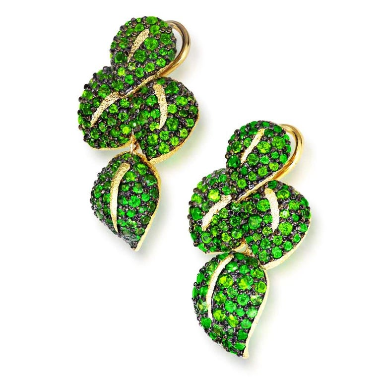 Alex Soldier Sunflower Green Leaf Earrings are a stunning work of art made in 18 karat yellow gold with tsavorites (green garnets) and Siberian chrome diopside, also known as Siberian emerald. These lovely earrings feature 8 gold leafs, each