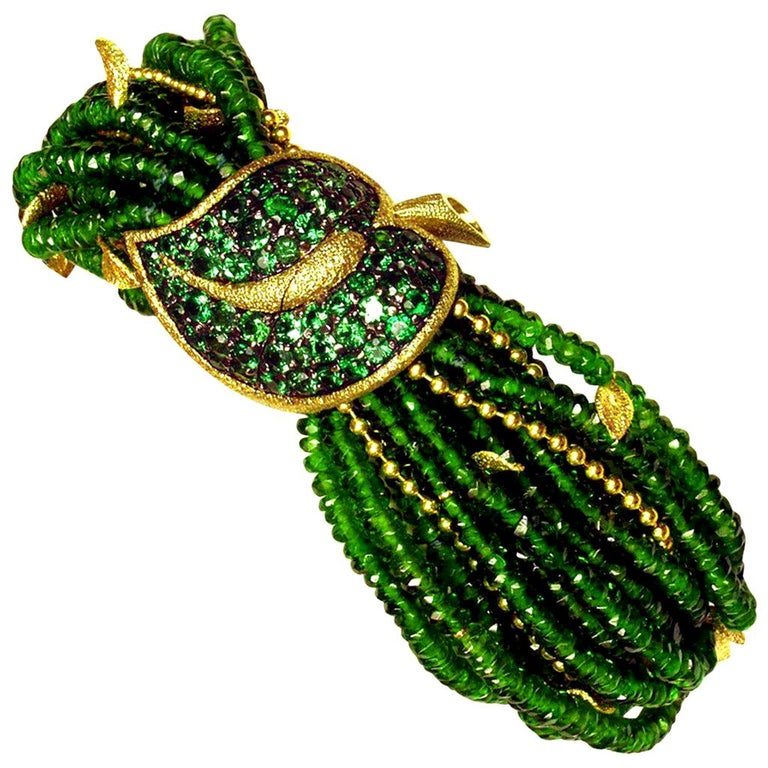 Alex Soldier Green Leaf Bracelet is a stunning work of art made in 18 karat yellow gold with 5 carats of tsavorites (green garnets) and 350 carats of Siberian chrome diopside beads, also known as Siberian emerald. The bracelet features Alex Soldier