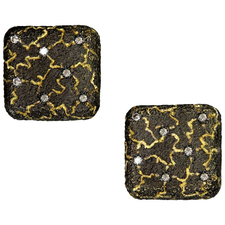 Alex Soldier Diamond Lava stud earrings: made in 18 karat yellow gold with diamonds (0.12 ct) and signature metalwork that creates an illusion of inner shimmer. Handmade in NYC. Complimentary conversion to cufflinks is available within 2 business