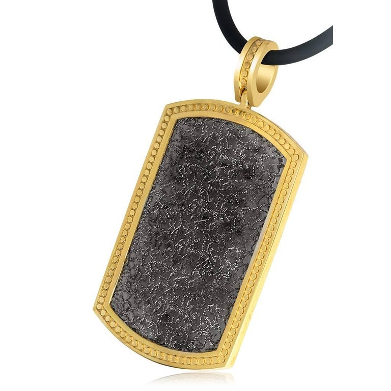 Alex Soldier Tag Necklace Pendant is made in sterling silver, infused (deeply plated) with 24 karat yellow gold and dark platinum (rhodium). Suspended on 18-inch rubber cord, it features signature metalwork that creates an effect of inner sparkle.