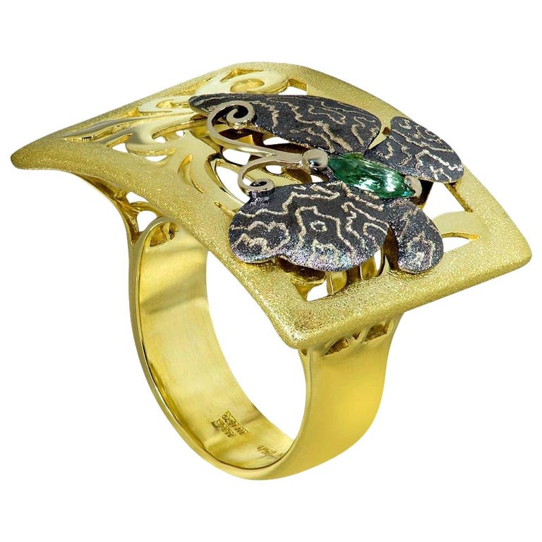 Alex Soldier's Butterfly collection is dedicated to celebration of life. Butterflies remind us to enjoy the moment and embrace change. Made in 18 karat yellow gold with green tourmaline (0.3 ct.), this lovely butterfly ring is finished with Alex