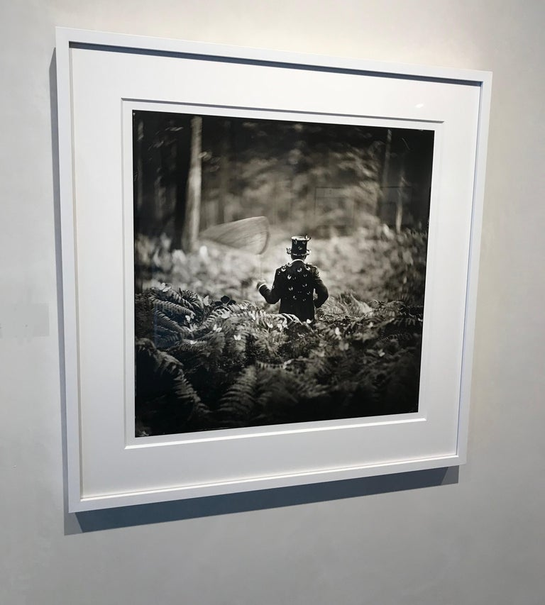 Hide and Seek- white framed black and white photograph 28 x 28 inches framed - Surrealist Photograph by Alex Timmermans