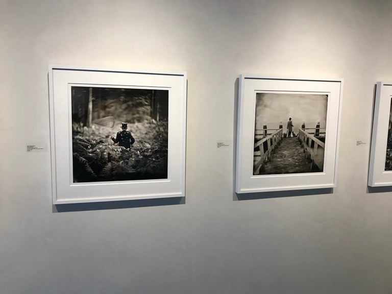 Hide and Seek- white framed black and white photograph 28 x 28 inches framed - Black Figurative Photograph by Alex Timmermans