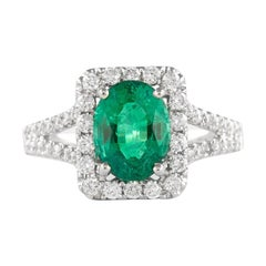 Alexander 1.69 Carat Emerald with Diamond Halo Ring 18 Karat White Gold
